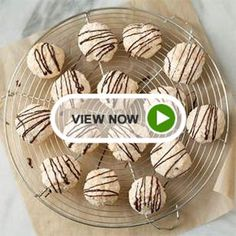 Take coconut macaroons to the next level by adding a decadent dark chocolate drizzle in this easy dessert recipe.