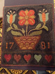 Berks County floral hooked rug by Barb Carroll