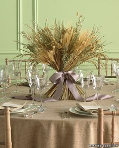 Harvest Centerpiece...A table arrangement of grains celebrates the bounty of fall. In addition to wheat, which symbolizes a fruitful life, this textured display includes other dried grasses (available at crafts stores), so it can be made weeks ahead. The final flourish? A luxurious satin bow.