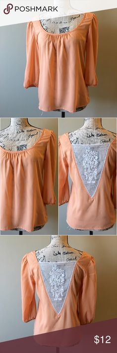 """F21 semi sheer lace back 3/4 sleeve top Semi sheer 3/4 length puff sleeve with scoop neck and a lace v-back blouse. There are a few marks in the back as seen in photo. They are not stains but rather flaws in the fabric. Price is reflected. Bust is 36"""", length is 23.5"""" Forever 21 Tops Blouses"""