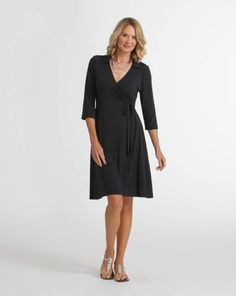 """<p>We can't get enough of wrap tie styles like our Black Tie Dress. From work to weddings, this timeless classic has you covered for all occasions, seasons, and years to come. <em>92% rayon, 8% spandex, ¾ sleeve, faux wrap, cross-over neck, hits just above knee, pointed collar, rouching at front tie, elegant & professional silhouette, Made in USA</em></p> Model dress size: 4 Model height: 5'10"""" Size on model: Small"""