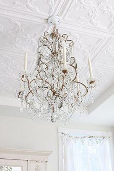 Ceiling tiles: styrofoam tiles can go over popcorn http://www.decorativeceilingtiles.net/white-styrofoam-ceiling-tiles/
