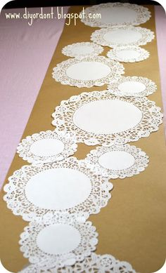 Doily and Kraft Paper Table Runner. The doilies would look lovely against a red runner. Or black, or . Doilies Crafts, Paper Doilies, Paper Doily Crafts, Deco Champetre, Paper Table, Baptism Party, Wedding Decorations, Table Decorations, Centerpieces