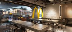 McDonald's Restaurant Interior Design Is Part of a Smart Rebranding Strategy Mcdonald's Restaurant, Restaurant Interior Design, Break Room, Mcdonalds, Table, Healthy Options, Furniture, Home Decor