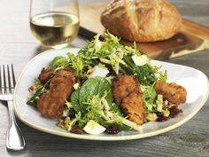 FRIED CHICKEN & SPINACH SALAD @ Salt Creek Grille   Honey-Battered, Fried Chicken Breast, Baby Spinach, Frisée, Fuji Apples, Hard-Boiled Egg, Applewood-Smoked Bacon, Toasted Cashews & Walnuts, Aged White Cheddar, Dried Cranberries, Dijon Vinaigrette