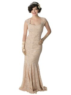 <p>Vintage inspired sequined champagne lace gown hugs the figure in the most flattering way! An enchanting look for an informal wedding dress or fancy dress ball. Pair with 40s inspired strappy platform heels, long satin gloves and a beaded clutch. Add some sparkly dress clips or pins to the sides of the neckline for an extra touch of retro glam!</p> <p>DETAILS <br />•Tan color soft jersey fabric is overlaid by champagne lace that is sprinkled with silver sequins. <br />•Square cut...