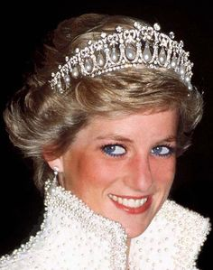 Princess Diana is pictured in Hong Kong in 1989, wearing a pearl and diamond tiara that was a wedding gift from the Queen       Catherine...