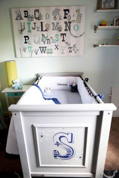 This is totally in-line with our 2014 #nursery trend of cribs with personality. Love the custom decal on this crib!