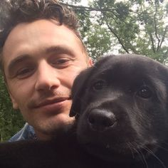 James Franco with a puppy