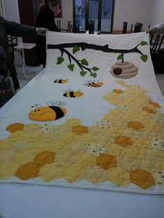 A fun beehive quilt with large hexies.