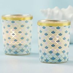 Intricate and shimmery, these seaside glass votive holder favors will light up your nautical themed wedding decor and truly bring a seaside vibe to your event. #NauticalWeddingFavors #GlassVotiveHolderWeddingFavors #NauticalFavorIdeas