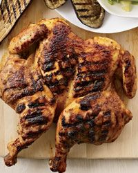 Roasting a whole chicken takes about an hour, but cut out the backbone and flatten the bird and it will grill perfectly in 30 minutes. Melissa Rubel rubs the chicken with a simple, Thai-inspired mix of red curry paste, coconut milk, and brown sugar. Grilling Recipes, Wine Recipes, Cooking Recipes, Easy Recipes, Grilling Ideas, Barbecue Recipes, Curry Recipes, Delicious Recipes, Red Curry Chicken