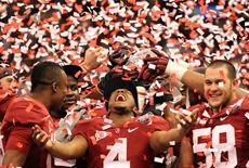 Alabama wide receiver Marquis Maze (4) reacts after the Crimson Tide defeated the LSU Tigers 21-0 in the BCS championship game in New Orleans.
