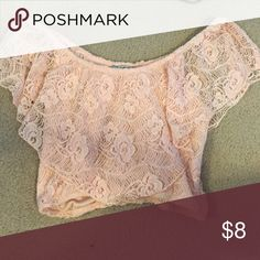 Peach crop top Light pink/peach Lacey crop top. Never worn Charlotte Russe Tops Crop Tops