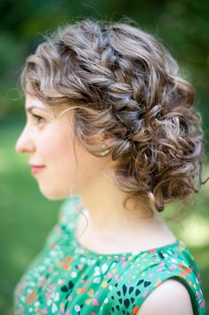 Natural Curly Hair in a loose messy bun with a loose side braid