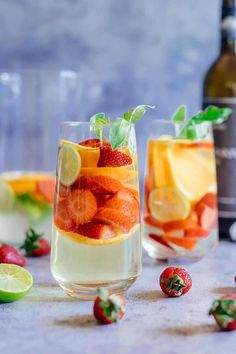 Strawberry Orange White Wine Sangria served in two glasses with limes and basil