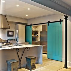 The Schrums' walk-in pantry holds the refrigerator and additional storage space.