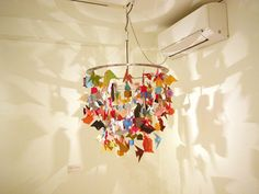 Collaborative origami chandelier for classroom - I should have done this last year when we got on an origami kick while studying Asia.