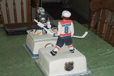 square off hockey cake.  Washington Capitals Forward Alex Ovechkin vs. Buffalo Sabres Goalie Ryan Miller.  Sweet!