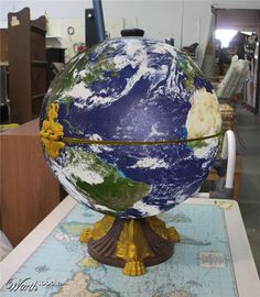 The old globe completely restored and fitted with the latest in LCD technology, showing a real time view of the earth from images transmitted from 28 satellites orbiting the planet. Total work of art, IMO.