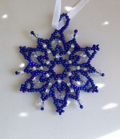 Rainbow Peacock Blue Beaded Snowflake Ornament with Swarvoski Crystals http://www.ecrafty.com/casearch.aspx?SearchTerm=snowflake