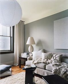 grey walls, grey couch - - would still look awesome with my white couches.