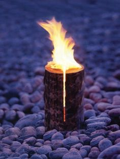 """Swedish flame: coolest Scandinavian invention. You will need; a log, chainsaw and fuel. Make cuts in the log like a pizza. Leave about 6"""" at the base. Throw some fuel in the middle (approximately a cap full). Let it burn (lasts 2-3 hours). Keep warm and cook something delicious! :)"""