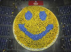 For Monday    Members of the Rotary International Convention 2012 gather to form the world's biggest smiley in Bangkok, Thailand.