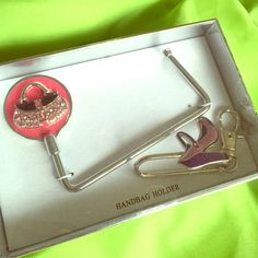 NIB Purse Holder w/Purse Art & Shoe Key Holder Excellent condition new in box, purse holder, made of metal. Has a handbag art on decoration. Great for anytime! Keeps your bag off the floor. Accessories