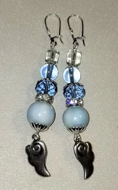 MJ-130; A Pair of Blue and Silver Earrings- Faceted Blue Glass, Blue and Clear Beads Silver Wings and Silver Lever Back Closures Silver Earrings, Drop Earrings, Silver Wings, Faceted Glass, Craft Items, Pearl White, Blue And Silver, Mj, Ear Piercings