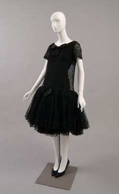 Woman's Cocktail Dress  Designed by Cristóbal Balenciaga, Spanish (active Spain and France), 1895 - 1972  Geography: Made in Paris, France, Europe Date: Winter 1958 Medium: Black starched silk lace, black silk chiffon, black silk taffeta, black net and horsehair, and black silk satin ribbon
