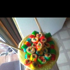 Candy sushi, looks like fruit roll-ups and rice crispies with fruit loops