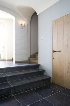 Entry hall by Bourgondisch Kruis-love the brick wall and the long stone slabs on the stairs. Belgian Blue, Belgian Style, Unique Flooring, Stone Flooring, Wood Floor Stairs, Barn Renovation, Interior And Exterior, Interior Design, Entrance Hall