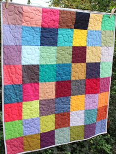 This quilt is ready to ship to you! This modern gender neutral baby quilt features a rainbow of 56 different colors . It is made using Kaffe