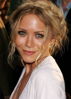 30 Best Hairstyles for Big Foreheads | herinterest.com - Part 2American actress, fashion designer, producer, author, and businesswoman Mary-Kate Olsen sports a cute braided up'do with loose tendrils of hair that frame her face. We love her messy crown braid, and her light, summery blonde hair color. Braided hairstyles draw attention away from a big forehead with their detailing, and wispy flyaway hairs with side bangs are a bonus as they further conceal the upper corners of your forehead