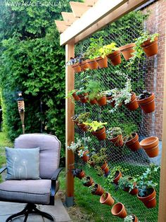 """DIY vertical garden with hex wire and terra cotta pots. Make tri-fold frame to loosely """"wrap"""" around Magnolia tree."""