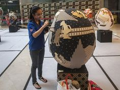 An art student applies traditional batik textile designs to a huge Easter egg at a shopping center in Surabaya, Indonesia. Juni Kriswanto, AFP/Getty Images