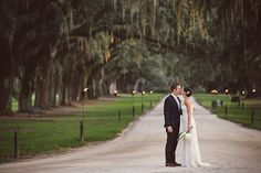 We're so proud this @boonehall Cotton Dock wedding was published in @TheWeddingRow  Her dress by @THEIACouture  from @lovelybridal  Florals by tailor and table Catering by @crucharleston  Lighting by @pdastage