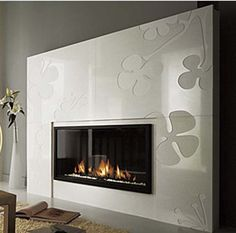 The semi built-in design fireplace from Chazelles offers a fun and funky look for a modern interior. The gorgeous 'Pivoines' design fireplace features smooth white decorative marble, with a. White Fireplace, Fireplace Wall, Fireplace Ideas, Contemporary Fireplace Designs, Family Room Decorating, Living Room Decor, Living Rooms, House Design, Interior Design