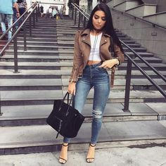 Fashion outfit for fall. Beige leather jacket with ripped jeans and sandal heels.