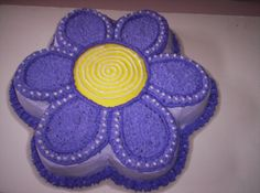 This cake I made for a co-workers little girls 2nd birthday. She wanted a purple flower. I think it turned out great.
