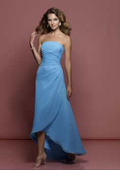 Bridesmaid dress shown made of chiffon and features side-draped details on strapless bodice and low high cut petal skirt at tea length. Custom-to-measurement for any size. Available in more colors shown in Color Option.