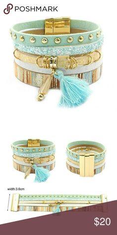 Aqua Boho Leather Wrap Charm Bracelet Boho leather wrap bracelet with tassel charm and magnet closure.   WE2SJEBU71217 Jewelry Bracelets
