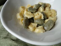 Cheese tortellini and spinach gnocchi with a lemon butter sauce.