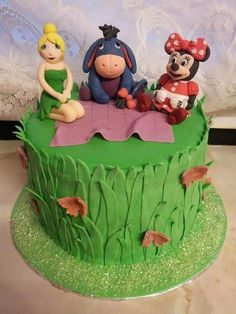 Tinkerbell, Eeyore and Minnie mouse cake www.facebook.com/bouchybakes