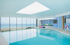 Infinity swimming pool overlooking the beach, Watergate Bay Hotel, Cornwall.