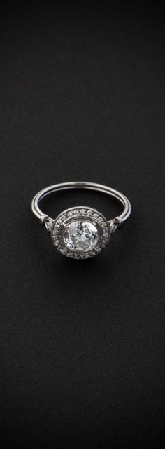 BEAUTIFUL! A stunning Vintage Old European Cut Diamond Engagement Ring, surrounded by a halo of diamonds and set in platinum.