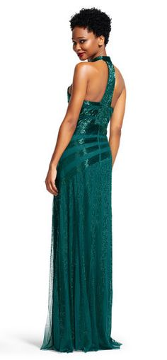 Adrianna Papell | Mock Neck Ray Beaded Halter Dress with T-Back | Stunning bands of sequins burst across the bodice of this mock neck dress. Featuring a sequin emblazoned t-back and lines of sequins running down the long skirt, this sparkling formal gown is most memorable. Paired with a contrasting metallic heel, this halter dress is unforgettable.