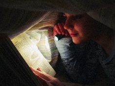 Reading books under the covers with a flashlight after bed time