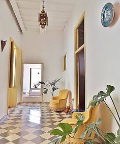 Yellow chairs and plants - Get $25 credit with Airbnb if you sign up with this link http://www.airbnb.com/c/groberts22